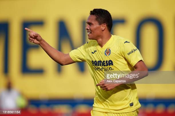 Carlos Bacca of Villarreal CF celebrates after scoring his team's first goal during the La Liga Santander match between Villarreal CF and Sevilla FC...