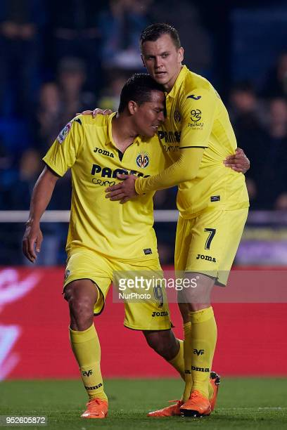 Carlos Bacca of Villarreal CF celebrates after scoring with his teammate Cheryshev during the La Liga game between Villarreal CF and Real Club Celta...