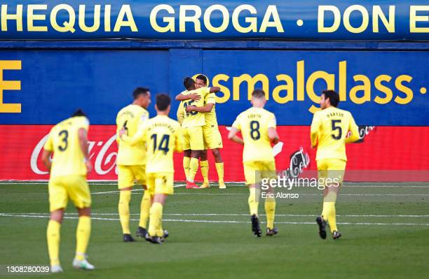 Carlos Bacca of Villarreal CF celebrates with Pervis Estupinan after scoring their side's second goal during the La Liga Santander match between...