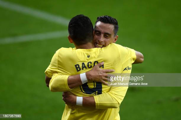 Carlos Bacca of Villarreal CF celebrates with Ramiro Funes Mori after scoring their side's second goal during the La Liga Santander match between SD...