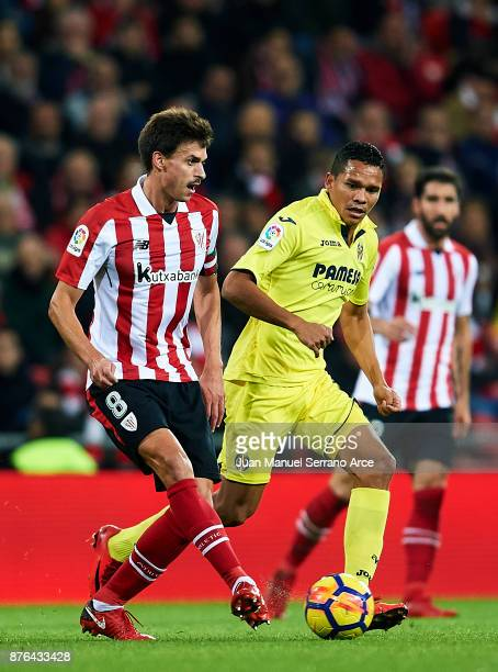 Carlos Bacca of Villarreal CF competes for the ball with Ander Iturraspe of Athletic Club during the La Liga match between Athletic Club Bilbao and...