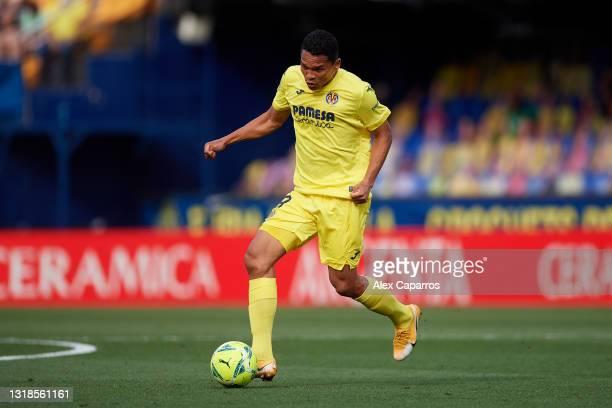 Carlos Bacca of Villarreal CF runs with the ball during the La Liga Santander match between Villarreal CF and Sevilla FC at Estadio de la Ceramica on...