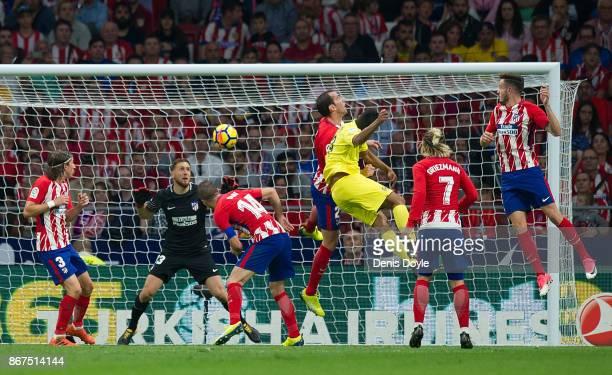 Carlos Bacca of Villarreal CF scores his team's opening goal during the La Liga match between Atletico Madrid and Villarreal at Estadio Wanda...