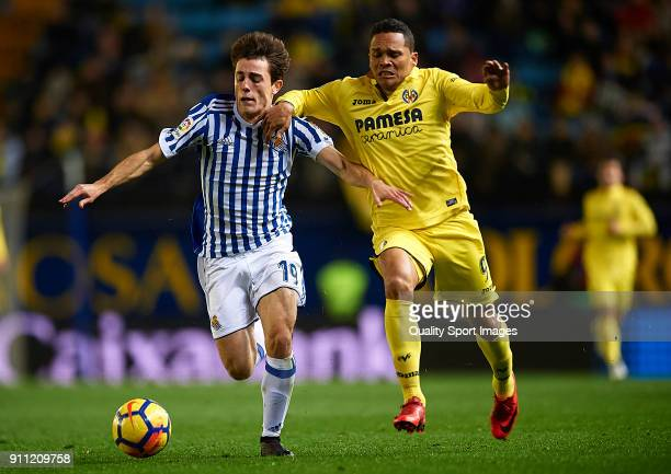 Carlos Bacca of Villarreal competes for the ball with Alvaro Odriozola of Real Sociedad during the La Liga match between Villarreal and Real Sociedad...