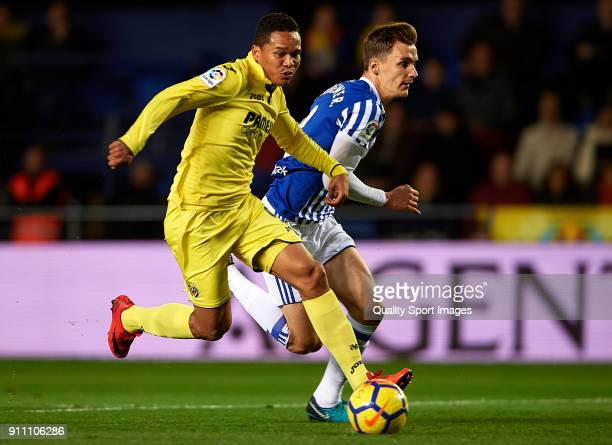 Carlos Bacca of Villarreal competes for the ball with Diego Llorente of Real Sociedad during the La Liga match between Villarreal and Real Sociedad...