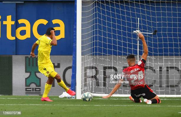 Carlos Bacca of Villarreal scores his teams first goal during the Liga match between Villarreal CF and RCD Mallorca at Estadio de la Ceramica on June...