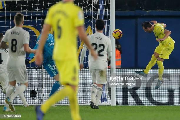 Carlos Bacca of Villarreal scores the fourth goal to make it 2-2 during the La Liga Santander match between Villarreal v Real Madrid at the Estadio...