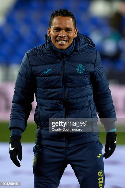 Carlos Bacca of Villarreal warms up during the Copa del Rey Round of 16 first Leg match between UD Leganes and Villarreal CF at Estadio Municipal de...