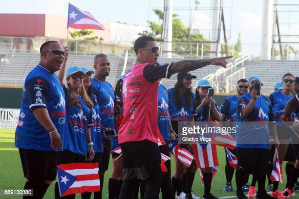 Carlos Baerga Javier Baez and 'Blue Team' participates to the Yadier Molina Celebrity Softball Game at Hiram Bithorn Stadium on December 9 2017 in...