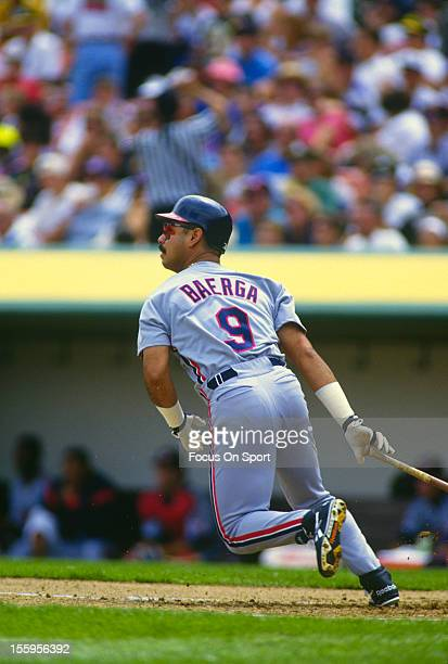 Carlos Baerga of the Cleveland Indians bats against the Oakland Athletics during an Major League Baseball game circa 1990 at the Oakland-Alameda...
