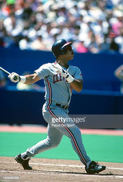 Carlos Baerga of the Cleveland Indians bats against the Toronto Blue Jays during an Major League Baseball game circa 1991 at the Sky Dome in Toronto,...