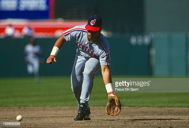 Carlos Baerga of the Cleveland Indians goes down to field a ground ball against the Baltimore Orioles during an Major League Baseball game circa 1992...