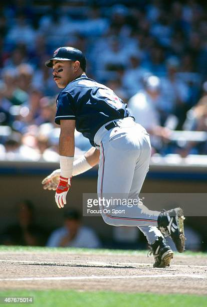 Carlos Baerga of the Cleveland Indians puts the ball in play and runs towards first base against the New York Yankees during an Major League Baseball...