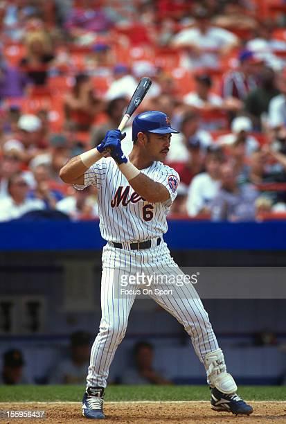 Carlos Baerga of the New York Mets bats during an Major League Baseball game circa 1996 at Shea Stadium in the Queens borough of New York City Baerga...