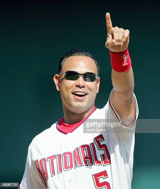 Carlos Baerga of the Washington Nationals celebrates during the game with the Seattle Mariners on May 19 2005 at RFK Stadium in Washington DC the...