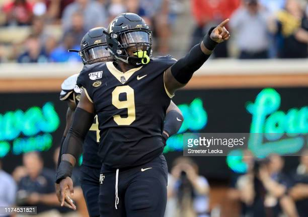 Carlos Basham Jr #9 of the Wake Forest Demon Deacons reacts after a defensive play against the North Carolina Tar Heels during their game at BBT...
