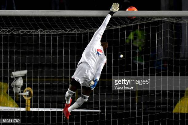 Carlos Bejarano goalkeeper of America makes a save during a match between Millonarios and America de Cali as part of the round 9 of Liga Aguila I at...
