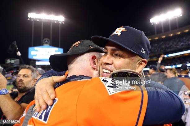 Carlos Beltran and Brian McCann of the Houston Astros celebrate on the field after the Astros defeated the Los Angeles Dodgers in Game 7 of the 2017...