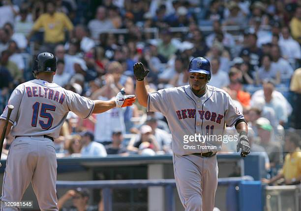 Carlos Beltran and Ramon Castro of the New York Mets at Yankee Stadium on July 1 2006 in New York The Mets defeated the Yankees 83