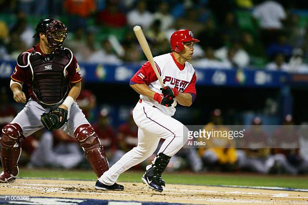 Carlos Beltran of Puerto Rico bats against Venezuela in the second round of the World Baseball Classic at Hiram Bithorn Stadium on March 13 2006 in...