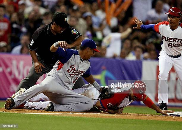 Carlos Beltran of Puerto Rico over slides third base and is tagged out by Javier Castillo of Panama during the 2009 World Baseball Classic Pool D...