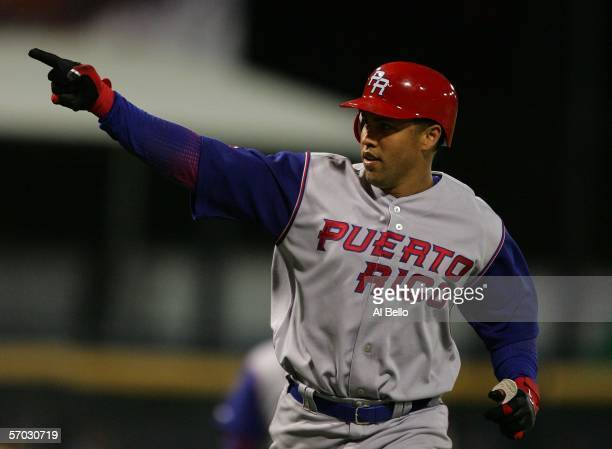 Carlos Beltran of Puerto Rico rounds the bases after hitting a home run against The Netherlands during their game at the World Baseball Classic at...