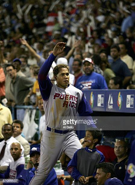 Carlos Beltran of Puerto Rico takes a curtain call after hitting a tworun home run against Cuba during their game at the World Baseball Classic at...