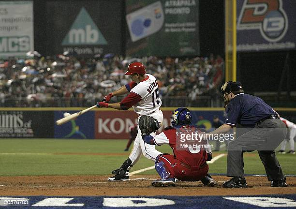 Carlos Beltran of team Puerto Rico hits an RBI single during a 2nd round game against team Cuba during the 2006 World Baseball Classic at Hiram...