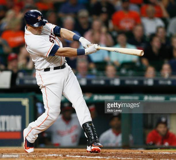 Carlos Beltran of the Houston Astros doubles in the eighth inning against the Washington Nationals at Minute Maid Park on August 24 2017 in Houston...