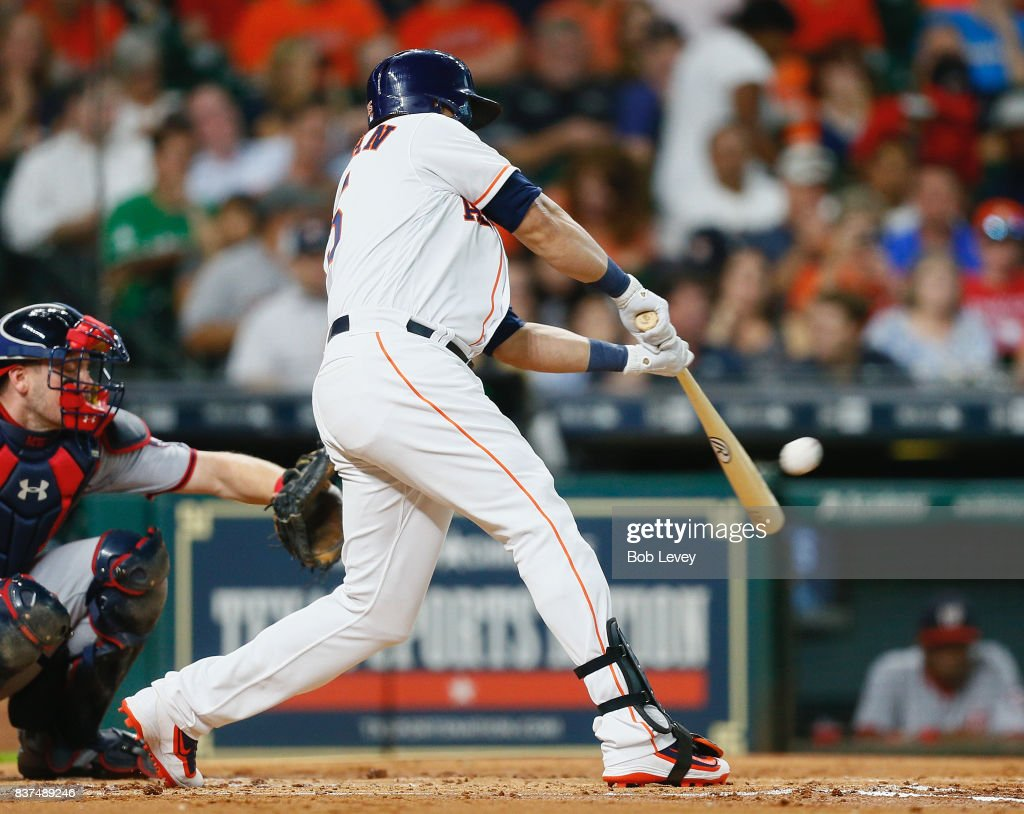 Carlos Beltran #15 of the Houston Astros doubles in the second inning against the Washington Nationals at Minute Maid Park on August 22, 2017 in Houston, Texas.