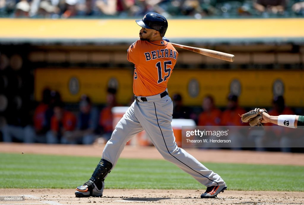 Carlos Beltran #15 of the Houston Astros hits a sacrifice fly scoring Jake Marisnick #6 against the Oakland Athletics in the top of the first inning at Oakland Alameda Coliseum on June 22, 2017 in Oakland, California.