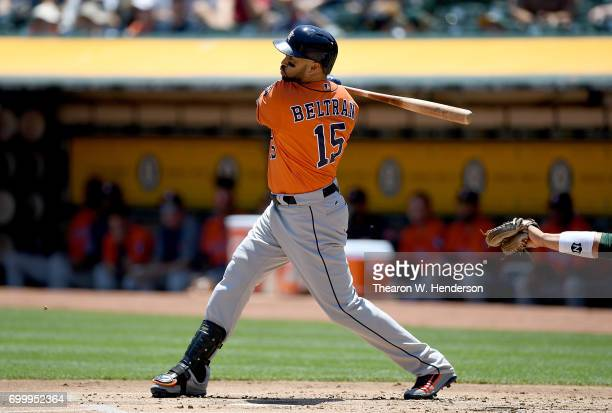 Carlos Beltran of the Houston Astros hits a sacrifice fly scoring Jake Marisnick against the Oakland Athletics in the top of the first inning at...