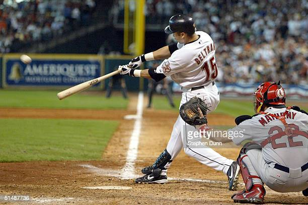 Carlos Beltran of the Houston Astros hits a solo home run in eighth inning of Game three of National League Championship Series against the St Louis...