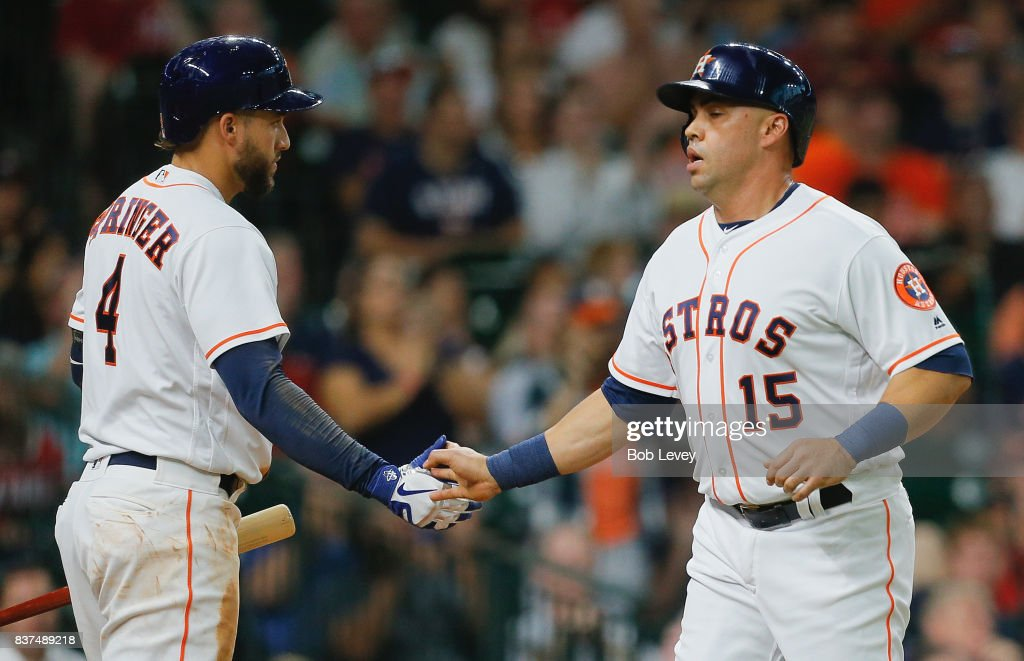 Carlos Beltran #15 of the Houston Astros is congratulated by George Springer #4 of the Houston Astros after scoring in the second inning against the Washington Nationals at Minute Maid Park on August 22, 2017 in Houston, Texas.