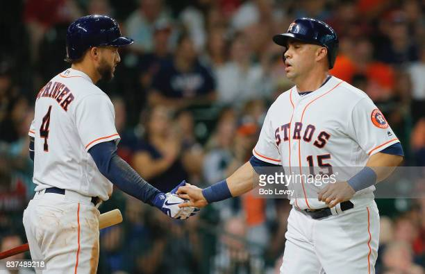 Carlos Beltran of the Houston Astros is congratulated by George Springer of the Houston Astros after scoring in the second inning against the...