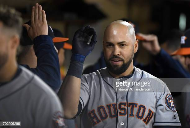 Carlos Beltran of the Houston Astros is congratulated by teammates after he hit a solo home run against the Oakland Athletics in the top of the ninth...