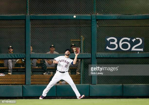 Carlos Beltran of the Houston Astros makes a catch on a deep fly ball by Khris Davis of the Oakland Athletics in the fourth inning at Minute Maid...
