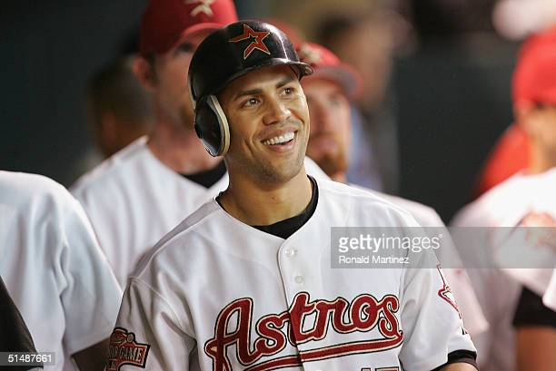 Carlos Beltran of the Houston Astros smiles in the dugout after hitting a solo home run in eighth inning of Game 3 of National League Championship...