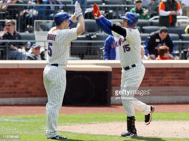 Carlos Beltran of the New York Mets celebrates his fifth inning two run home run against the San Francisco Giants with teammate David Wright on May 5...
