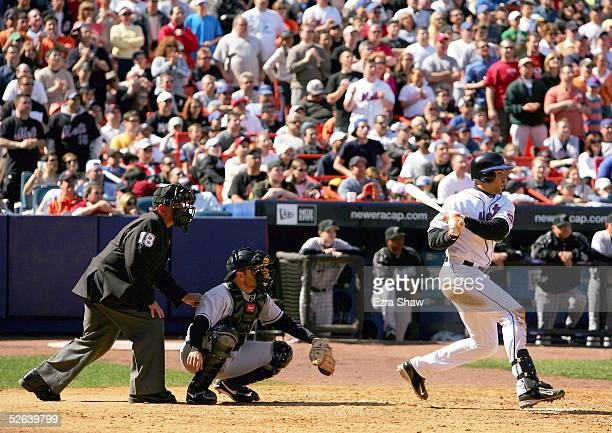 Carlos Beltran of the New York Mets hits a single that scored Victor Diaz to tie the score 22 in the eighth inning of their game against the Florida...