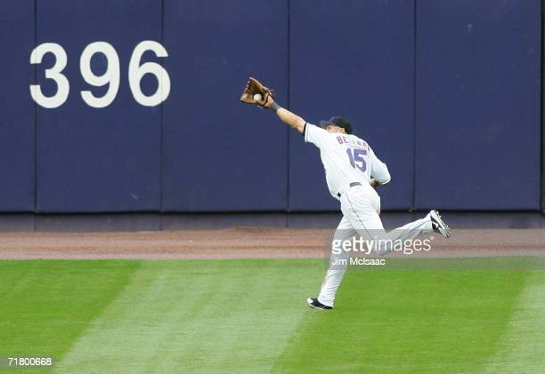 Carlos Beltran of the New York Mets makes a running catch in centerfield against the Atlanta Braves September 6, 2006 during the second game of their...