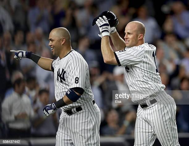Carlos Beltran of the New York Yankees celebrates his three run home run with teammate Brett Gardner in the eighth inning against the Los Angeles...
