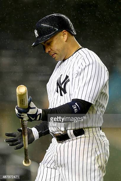 Carlos Beltran of the New York Yankees strikes out to end the game against the Seattle Mariners on April 29 2014 at Yankee Stadium in the Bronx...