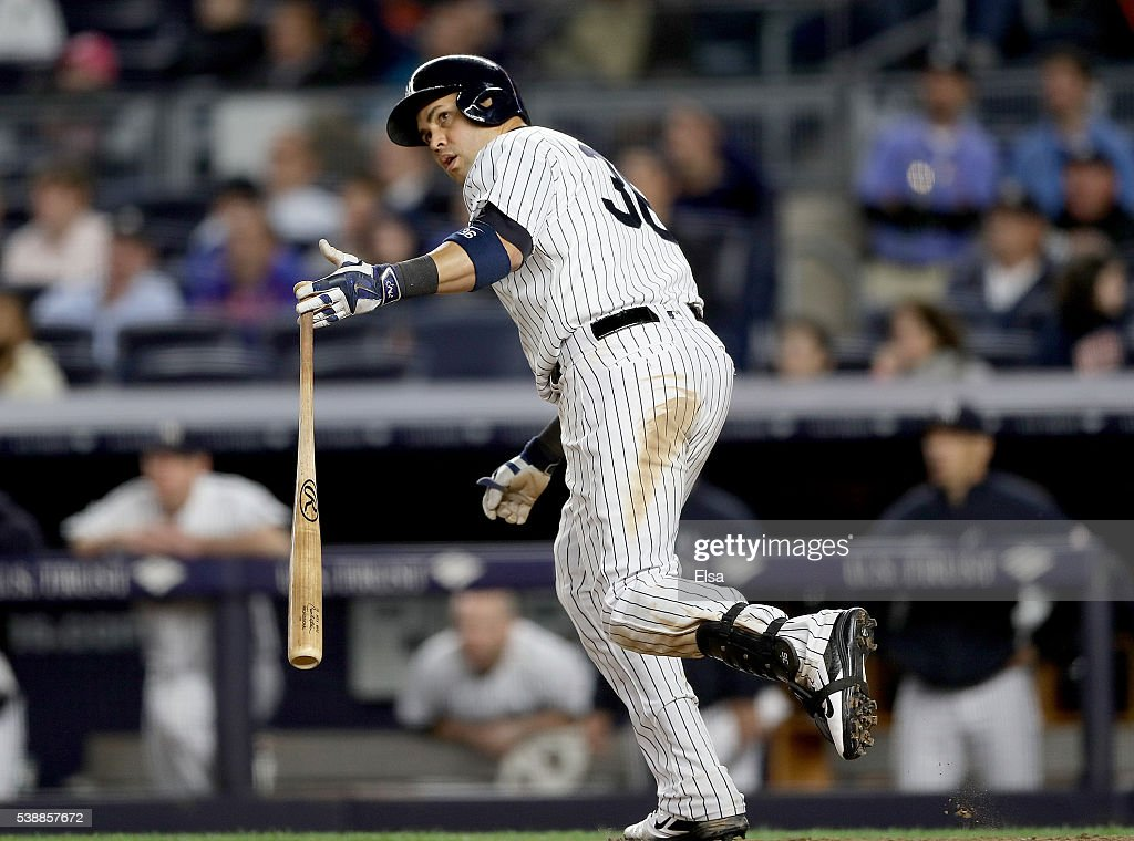 Carlos Beltran #36 of the New York Yankees watches his two run home run as he heads for first base in the seventh inning against the Los Angeles Angels at Yankee Stadium on June 8, 2016 in the Bronx borough of New York City.