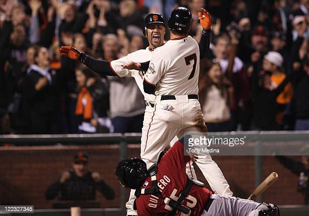 Carlos Beltran of the San Francisco Giants and Mark DeRosa of the San Francisco Giants celebrate after Mark DeRosa of the San Francisco Giants scored...