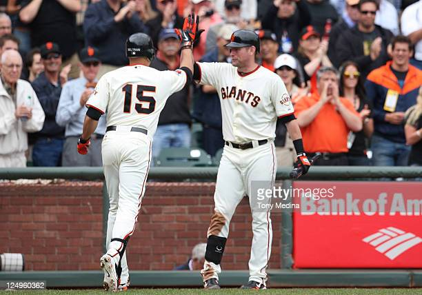 Carlos Beltran of the San Francisco Giants is congratulated by Aubrey Huff of the San Francisco Giants after hitting a solo home run in the bottom of...