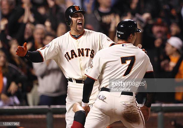 Carlos Beltran of the San Francisco Giants yells in celebration as Mark DeRosa of the San Francisco Giants is called safe at home and the San...