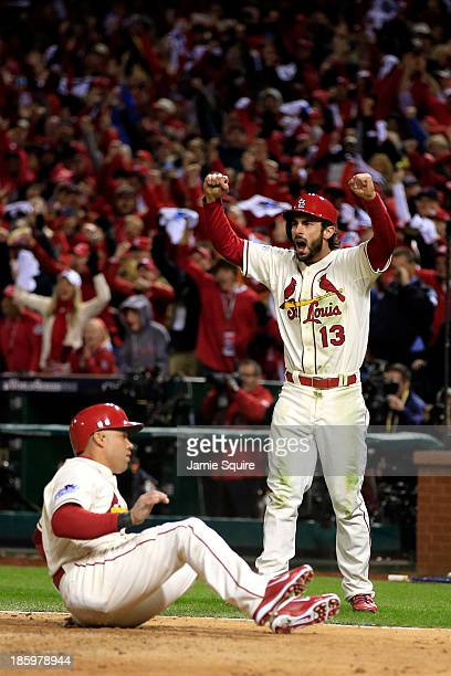 Carlos Beltran of the St Louis Cardinals and Matt Carpenter celebrate as they score on a double by Matt Holliday in the seventh inning against the...