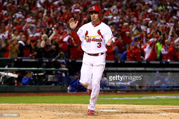 Carlos Beltran of the St Louis Cardinals celebrates after scoring a run in the third inning while taking on the Los Angeles Dodgers in Game Six of...