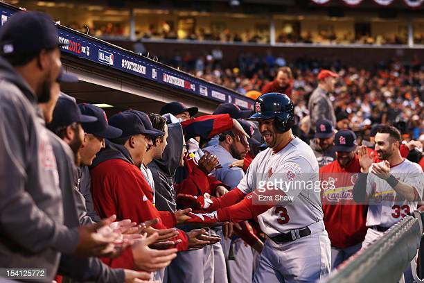 Carlos Beltran of the St Louis Cardinals celebrates his tworun home run with teammates in the dugout during the fourt inning of Game One of the...
